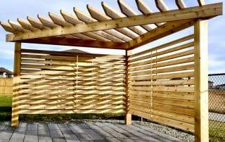 Corner cedar pergola with privacy screen three posts