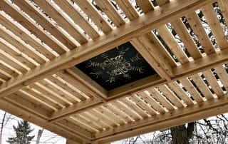 Cedar pergola with laser cut metal panel