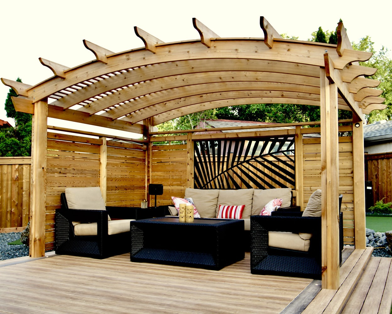 Curved cedar pergola with laser cut metal panel palm leaf