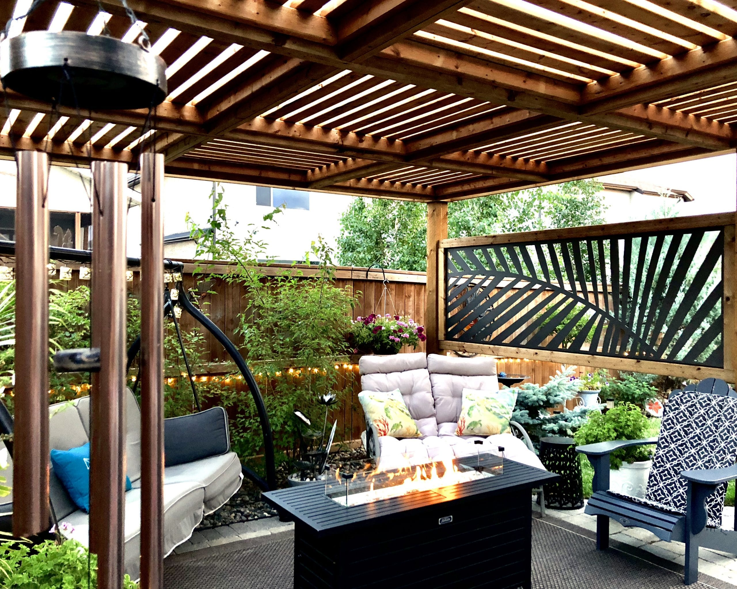Treated wood pergola with laser cut metal panel