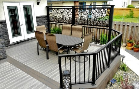 Wolf PVC deck with silver teak decking and Black Walnut boarder and metal privacy screen