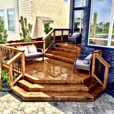 Brown treated deck with wrapping stairs and deck lights