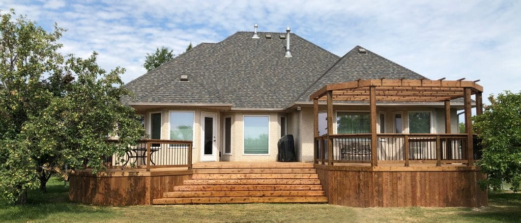 Brown treated deck with pergola