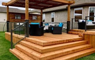 Cedar tone wood deck with pergola and privacy screen