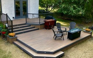 Wolf PVC deck with planters and wrapping stairs – Serenity decking