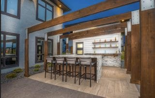 Outdoor bar with granite counter top and cedar pergola