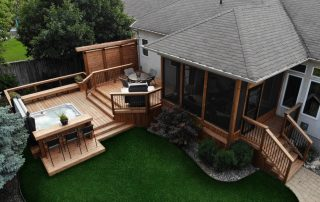 Cedar tone wood deck with hot tub and screen room