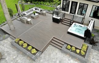 Composite deck with Serenity Wolf PVC Decking and topless glass rail