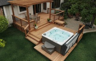 Brown treated wood hot tub deck with pergola